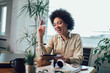 African american woman with digital tablet and credit card in home office