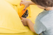 selective focus of boy with cute hamster on yellow sofa