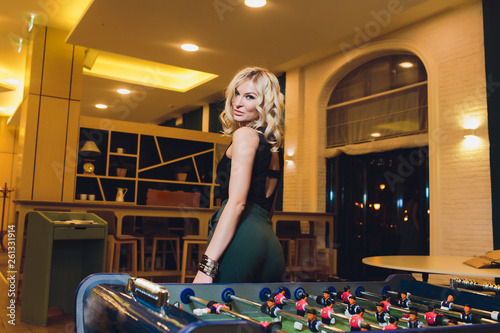 canvas print picture Young blond Office People Enjoying Table Soccer Game During their Free Time at the Workplace.