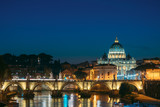 Rome, Italy. Papal Basilica Of St. Peter In The Vatican And Aelian Bridge In Evening Night Illuminations