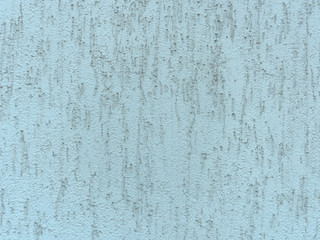 Seamless repeating texture of the plastered wall with cracks in. beige background
