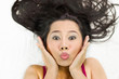 Quadro Closeup portrait of happy asian women  lying on ground with black long hair. acting smile, fun,