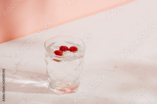 A glass of fresh soda with raspberries © makistock