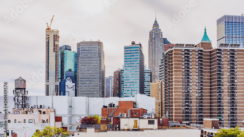 Buildings and skyscrapers of downtown Manhattan from Brooklyn Bridge, in New York, USA © Mark Zhu