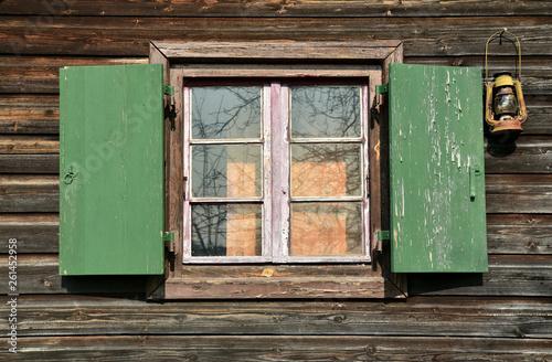 canvas print picture altes holzfenster mit grünen fensterläden in einer holzfassade