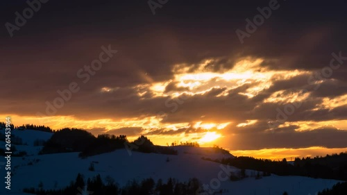 Colorful sunrise morning with clouds sky and sunbeam in winter nature landscape Time lapse