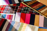 fabric samples laid out on the table in the sewing workshop
