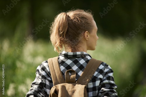 Young woman walking in the forest