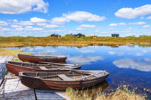 Acrylglas Pier Row boats at a mountain huts lake