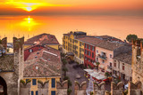 Sunset above old houses in Sirmione, Garda lake, Lombardy, Italy