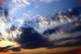 beautiful colorful with sun rays clouds on the sky for using in design as background.