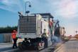 Quadro raboteuse et camion benne  en action