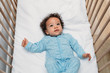 canvas print picture - Portrait of a cute baby boy wearing pajamas