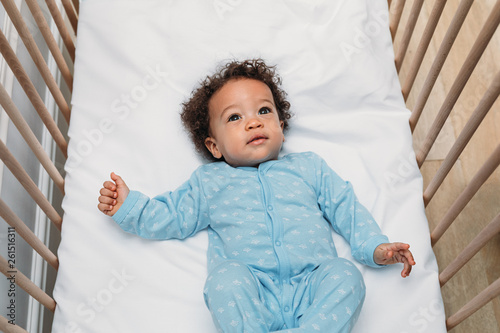 canvas print picture Portrait of a cute baby boy wearing pajamas
