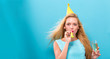Young woman with party theme on a blue background