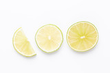 Composition with fresh ripe limes on light background, top view