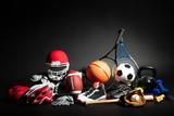 Fototapeta Coffie - Close-up Of Sport Balls And Equipment © Andrey Popov