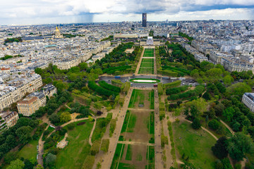 Aerial view of Champ de Mars from the top of Eiffel tower in cloudy day in Paris