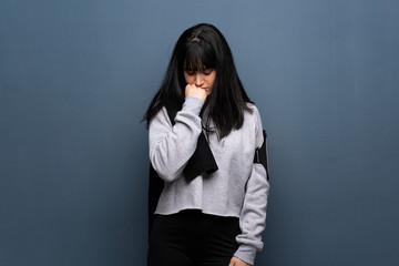 Young sport woman having doubts © luismolinero