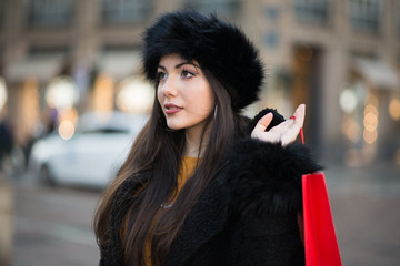 Young woman shopping in a city