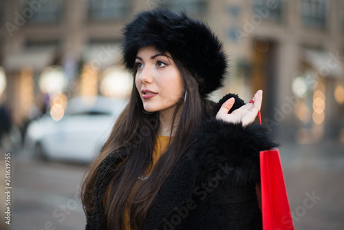 canvas print picture Young woman shopping in a city