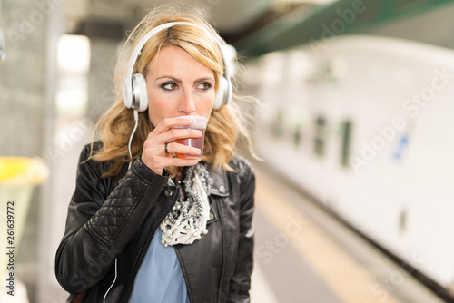 canvas print picture Woman listening music and drinking tea