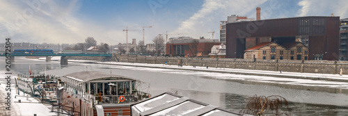 KRAKOW, POLAND - JANUARY 23, 2017: Barges on Wisla river on cold winter day