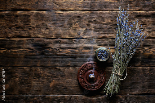 Dried lavender flower branch on a wooden table background with copy space. Herbal medicine concept. - 261687189