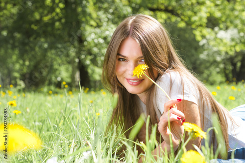 canvas print picture Woman laying on grass in park