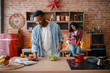 Black american love couple cooking on the kitchen