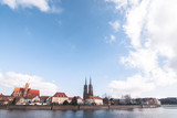 Ostrow Tumski with river Odra and beautiful stuffed clouds
