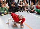 breakdance kids,dance battle, a child in a breakdance figure