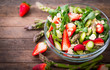 Leinwandbild Motiv Healthy asparagus salad with strawberries