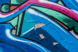 Putz bröckelt ab durch Graffities