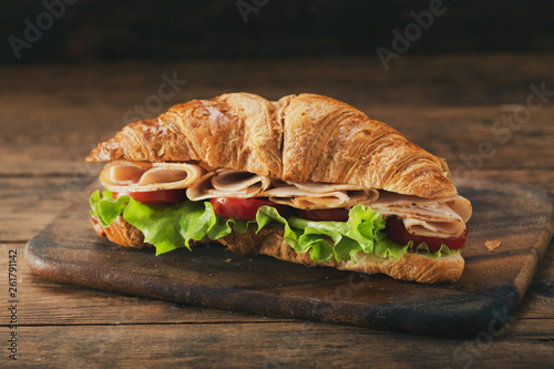 croissant sandwich with ham and vegetables © Nitr
