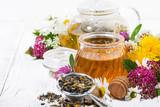 fresh flower honey, tea and ingredients on white wooden background