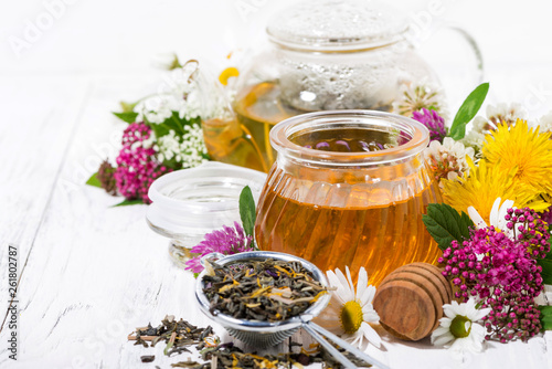 fresh flower honey, tea and ingredients on white wooden background © cook_inspire