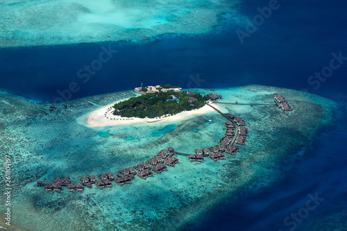 Leinwandbild Motiv aerial view of tropical paradise maldives island resort with coral reef turquoise blue ocean tourism background
