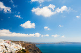 Blue sky with clouds over Santorini island, Greece. Beautiful landscape with sea view