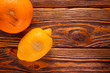 canvas print picture - rotten, spoiled lemons and oranges on wooden background flat lay