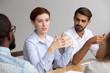 Leinwandbild Motiv Confident female leader speak at group training explain corporate strategy