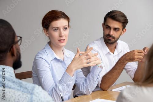 Leinwanddruck Bild Confident female leader speak at group training explain corporate strategy