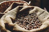 A bag of roasted coffee beans, standing at the window of the house.