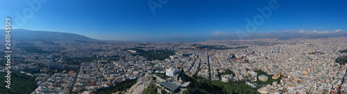 Aerial drone panoramic photo of iconic Saint George Lycabettus chapel as seen from top of hill, all Athens cityscape and Acropolis hill at the background, Athens historic centre, Attica, Greece - 261845129