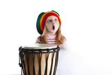 Expressive toddler girl portrait in rastafarian hat with drum