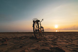 Bicycle on the beach at sunset - 261900120
