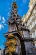 Plague column in Vienna on the background of the building and the blue sky