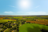 Village with farms in countryside in summer
