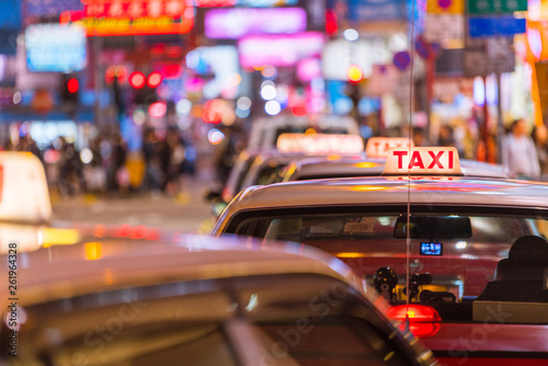 Leinwanddruck Bild Taxi Queue with light illuminated at Night in Shopping area, Hong Kong, China