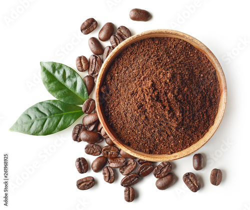 Bowl of ground coffee and beans isolated on white background © baibaz